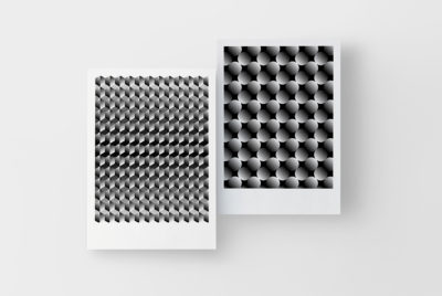 black and white gradient tile pattern-filled posters hanging