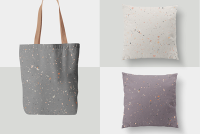 seamless flecked designs on pillows and a bag in natural hues