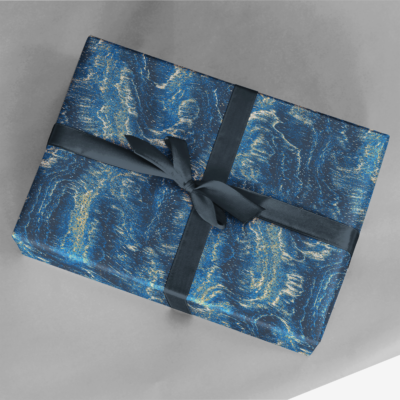 gift wrapped in bluish wood grain abstractions wrapping paper