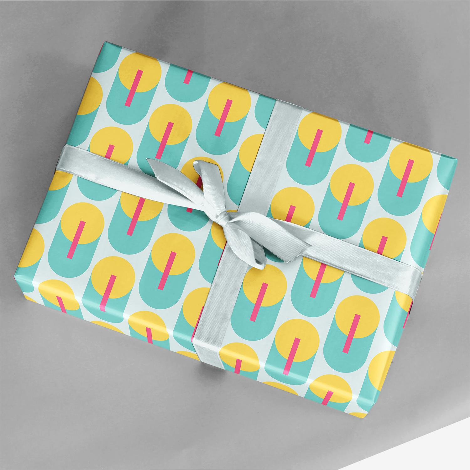 gift wrapped in blue and yellow geometric art deco gift wrap