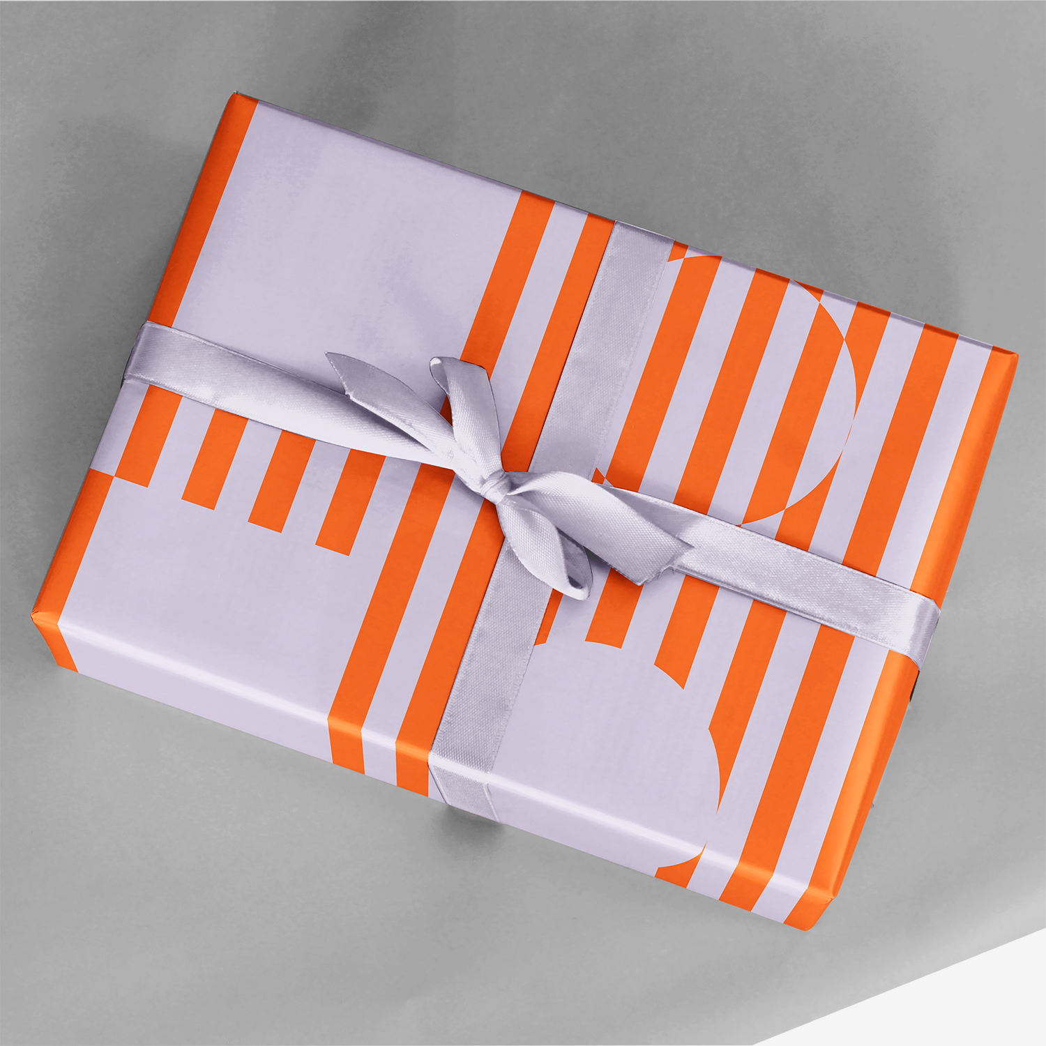 gift wrapped in bold orange chromasect wrapping paper