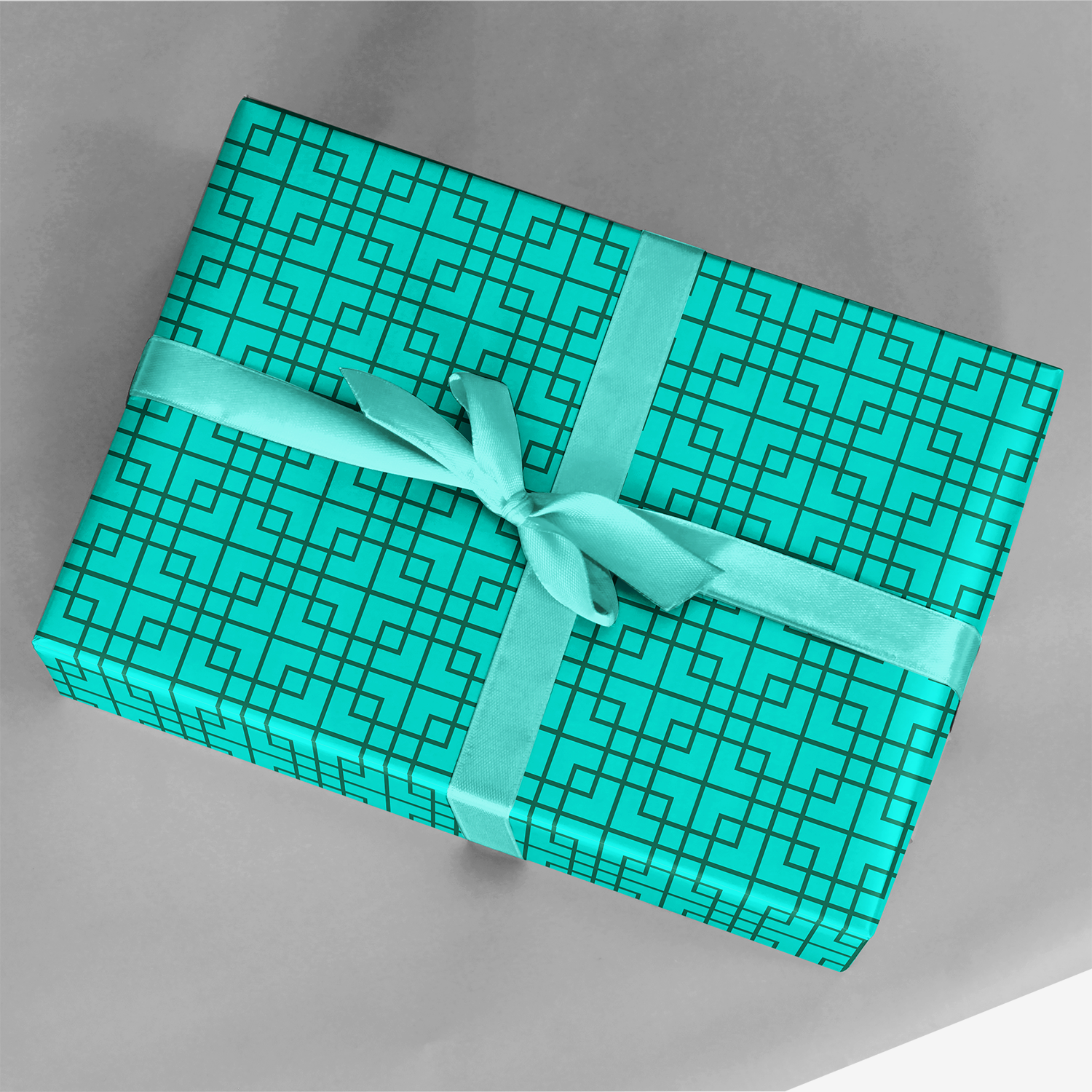 gift wrapped in bright turquoise blue lattice gift wrap with light blue ribbon
