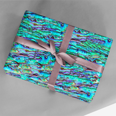 gift wrapped in bright turquoise and colorful iridescent abalone gift wrap with ribbon