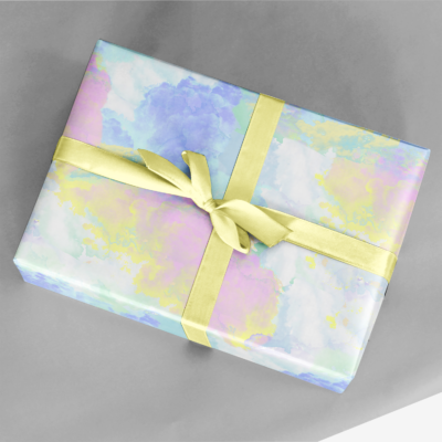 present wrapping in colorful pastel fluffy clouds gift wrap with yellow ribbon