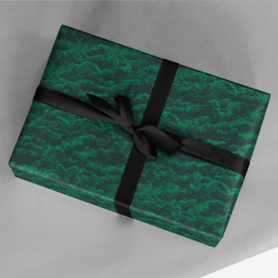 christmas gift wrapped in dark green holiday trees gift wrap
